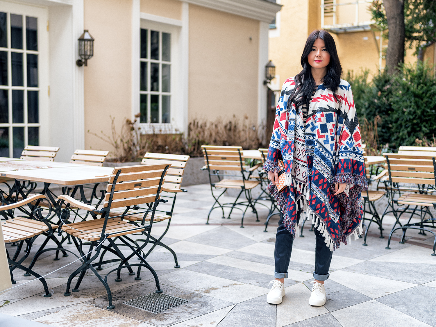 Fashionambit wearin coated dark blue jeans with stripped top and poncho by 1.2.3 Paris